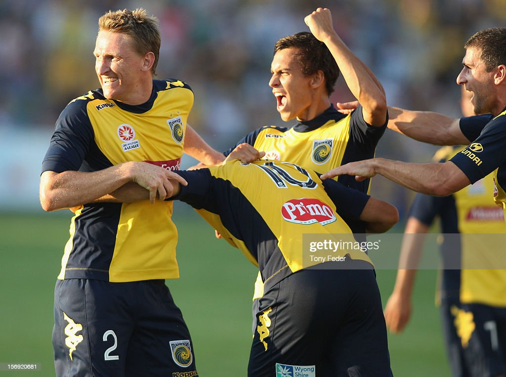 Daniel mcBreen (L) and Trent Sainsbury (R) celebrate a goal by Tomas Rogic (C) during the round eight A-League match between the Central Coast Mariners and the Brisbane Roar at at Bluetongue Stadium on November 25, 2012 in Gosford, Australia.