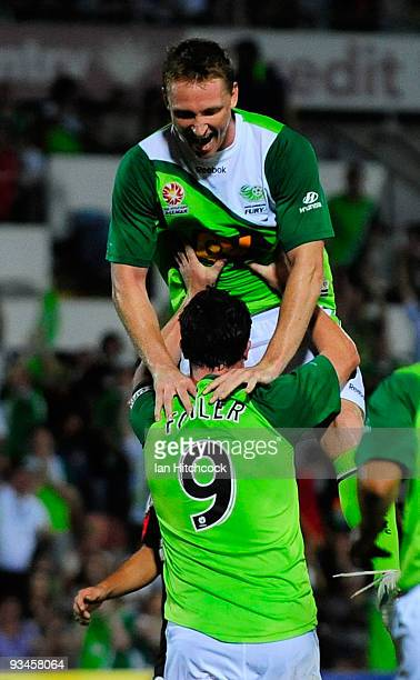 Daniel McBreen jumps up onto Robbie Fowler he scored the Furys second goal during the round 16 ALeague match between the North Queensland Fury and...