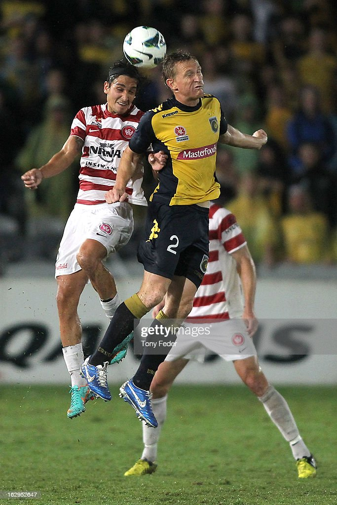 <a gi-track='captionPersonalityLinkClicked' href=/galleries/search?phrase=Daniel+McBreen&family=editorial&specificpeople=2229191 ng-click='$event.stopPropagation()'>Daniel McBreen</a> of the Central Coast Mariners contests a header with <a gi-track='captionPersonalityLinkClicked' href=/galleries/search?phrase=Jerome+Polenz&family=editorial&specificpeople=790750 ng-click='$event.stopPropagation()'>Jerome Polenz</a> of Western Sydney Wanderers during the round 23 A-League match between the Central Coast Mariners and the Western Sydney Wanderers at Bluetongue Stadium on March 2, 2013 in Gosford, Australia.