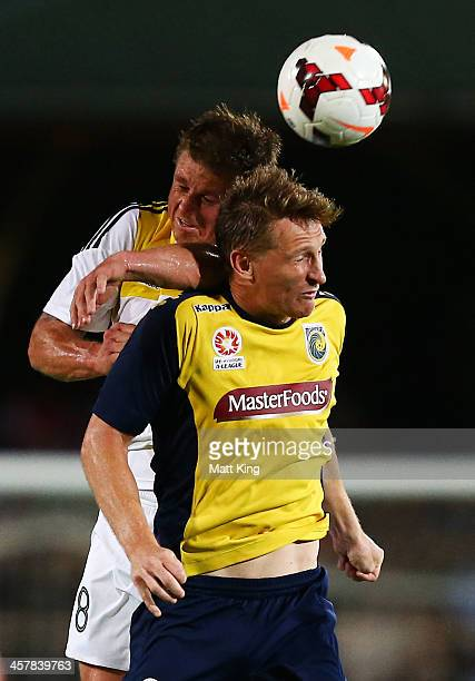 Daniel McBreen of the Mariners competes with Ben Sigmund of the Phoenix during the round six ALeague match between the Central Coast Mariners and...