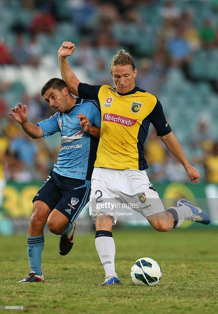 <a gi-track='captionPersonalityLinkClicked' href=/galleries/search?phrase=Daniel+McBreen&family=editorial&specificpeople=2229191 ng-click='$event.stopPropagation()'>Daniel McBreen</a> of the Mariners contests the ball with Peter Triantis of Sydney FC during the round 24 A-League match between Sydney FC and the Central Coast Mariners at Allianz Stadium on March 9, 2013 in Sydney, Australia.