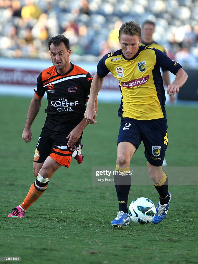 <a gi-track='captionPersonalityLinkClicked' href=/galleries/search?phrase=Daniel+McBreen&family=editorial&specificpeople=2229191 ng-click='$event.stopPropagation()'>Daniel McBreen</a> of the Mariners controls the ball in front of Ivan Franjic of Brisbane Roar during the round 25 A-League match between the Central Coast Mariners and the Brisbane Roar at Bluetongue Stadium on March 17, 2013 in Gosford, Australia.