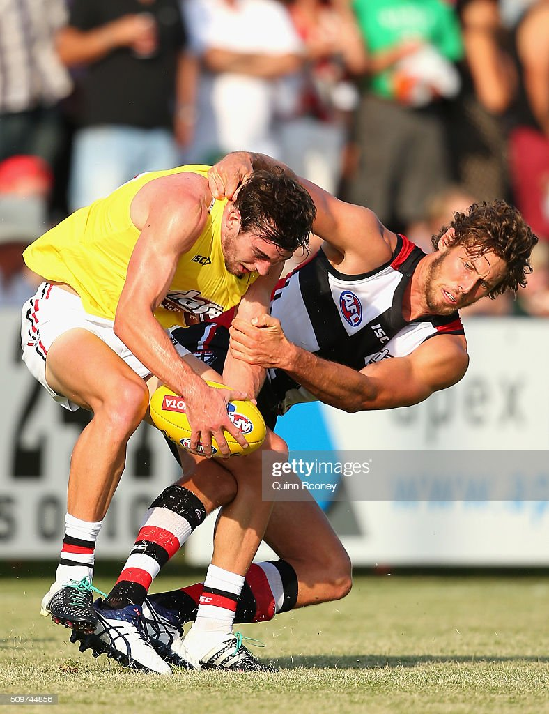 Daniel McKenzie of the Saints is tackled by Tom Hickey during the St Kilda Saints AFL Intra-Club Match at Trevor Barker Beach Oval on February 12, 2016 in Melbourne, Australia.