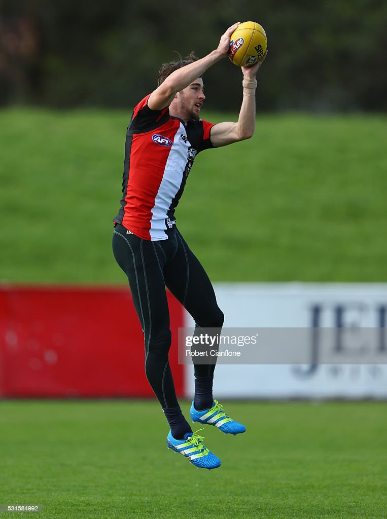 Daniel McKenzie of the Saints takes the ball during a St Kilda Saints AFL training session at Moorabbin Oval on May 27, 2016 in Melbourne, Australia.