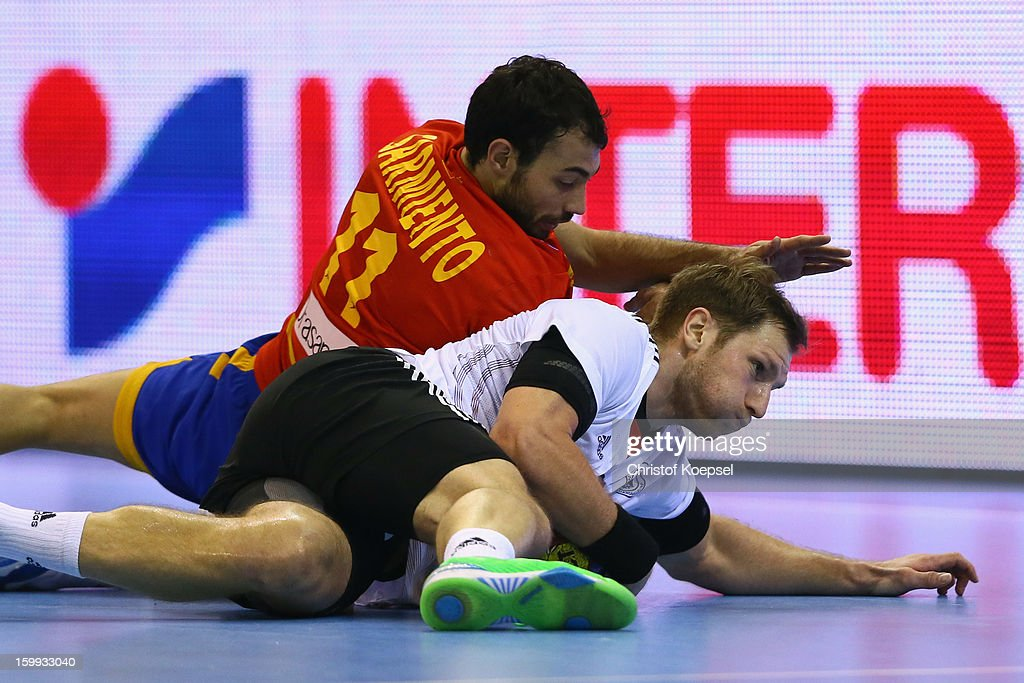 Daniel Melian of Spain and Steffen Weinhold of Germany fight for the ball during the quarterfinal match between Spain and Germany at Pabellon Principe Felipe Arena on January 23, 2013 in Barcelona, Spain.