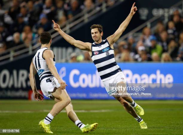 Daniel Menzel of the Cats celebrates a goal during the 2017 AFL round 11 match between the Geelong Cats and the Adelaide Crows at Simonds Stadium on...