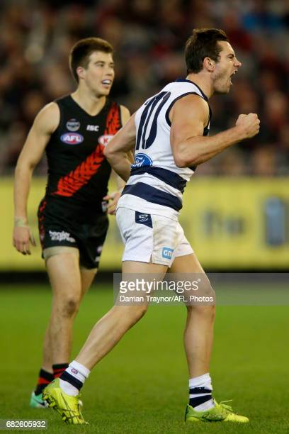 Daniel Menzel of the Cats celebrates a goal during the round eight AFL match between the Essendon Bombers and the Geelong Cats at Melbourne Cricket...