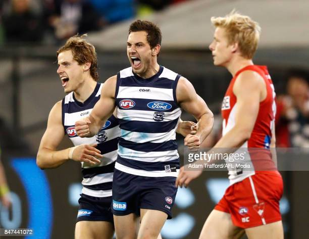 Daniel Menzel of the Cats celebrates a goal with Jake Kolodjashnij of the Cats during the 2017 AFL Second Semi Final match between the Geelong Cats...