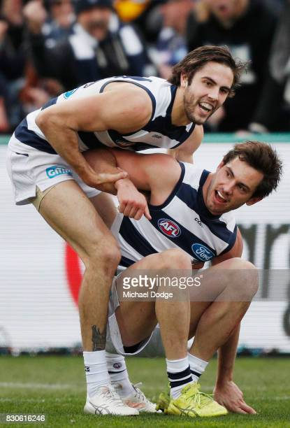 Daniel Menzel of the Cats celebrates a goal with James Parsons during the round 21 AFL match between the Geelong Cats and the Richmond Tigers at...