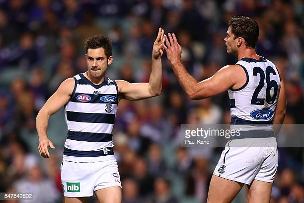 Daniel Menzel of the Cats celebrates a goal with Tom Hawkins during the round 17 AFL match between the Fremantle Dockers and the Geelong Cats at...