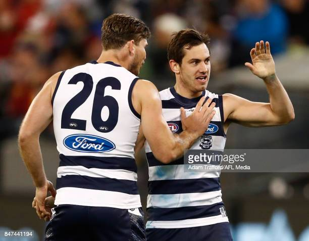 Daniel Menzel of the Cats celebrates a goal with Tom Hawkins of the Cats during the 2017 AFL Second Semi Final match between the Geelong Cats and the...