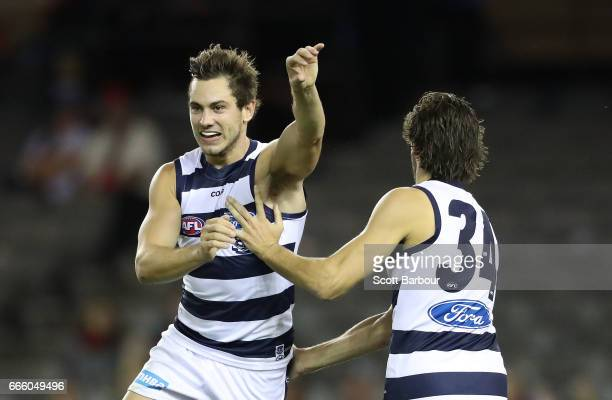 Daniel Menzel of the Cats celebrates after kicking a goal during the round three AFL match between the Geelong Cats and the Melbourne Demons at...