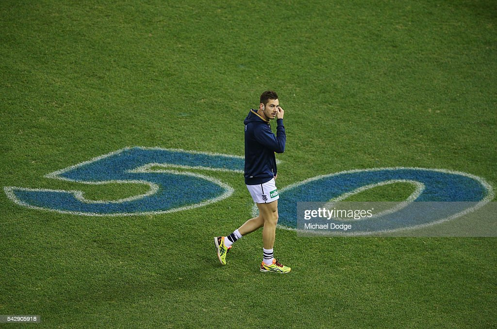 Daniel Menzel of the Cats inspects the turf before warm up during the round 14 AFL match between the St Kilda Saints and the Geelong Cats at Etihad Stadium on June 25, 2016 in Melbourne, Australia.