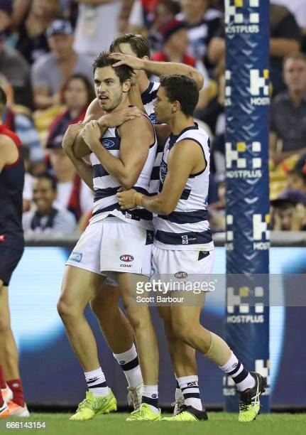 Daniel Menzel of the Cats is congratulated by his teammates after kicking a goal during the round three AFL match between the Geelong Cats and the...