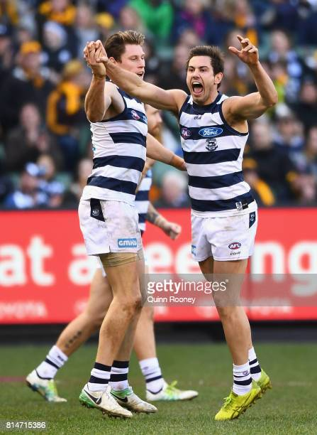 Daniel Menzel of the Cats is congratulated by Mark Blicavs after kicking a goal during the round 17 AFL match between the Geelong Cats and the...