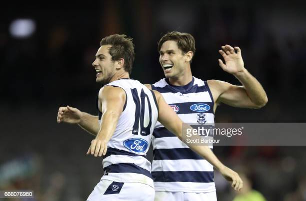 Daniel Menzel of the Cats is congratulated by Tom Hawkins of the Cats after kicking a goal during the round three AFL match between the Geelong Cats...