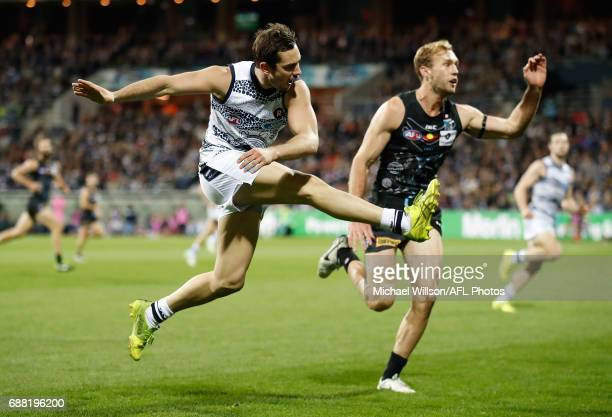 Daniel Menzel of the Cats kicks the ball during the 2017 AFL round 10 match between the Geelong Cats and Port Adelaide Power at Simonds Stadium on...