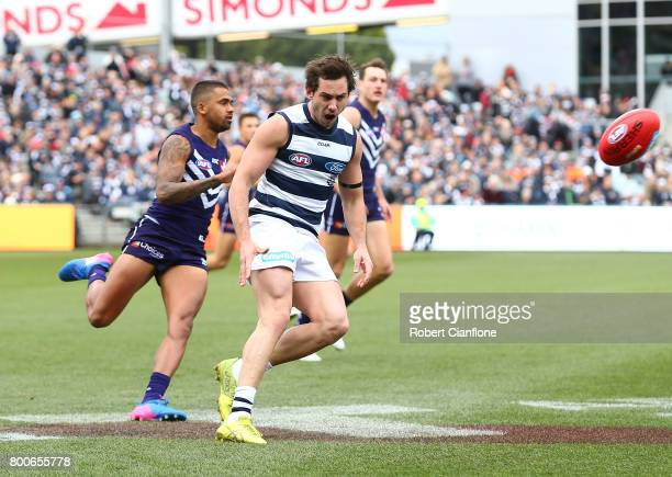 Daniel Menzel of the Cats kicks the ball during the round 14 AFL match between the Geelong Cats and the Fremantle Dockers at Simonds Stadium on June...