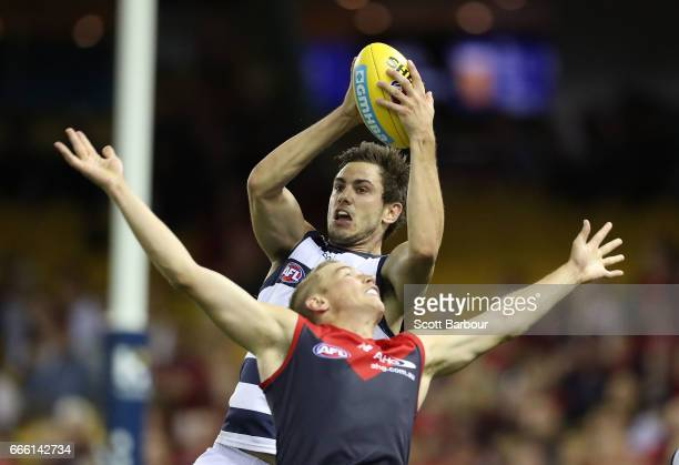 Daniel Menzel of the Cats marks the ball during the round three AFL match between the Geelong Cats and the Melbourne Demons at Etihad Stadium on...