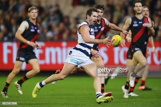 Daniel Menzel of the Cats misses a kick for goal during the round eight AFL match between the Essendon Bombers and the Geelong Cats at Melbourne...