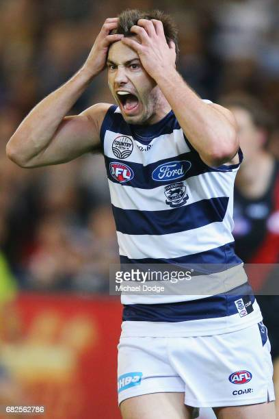 Daniel Menzel of the Cats reacts after missing a kick for goal during the round eight AFL match between the Essendon Bombers and the Geelong Cats at...