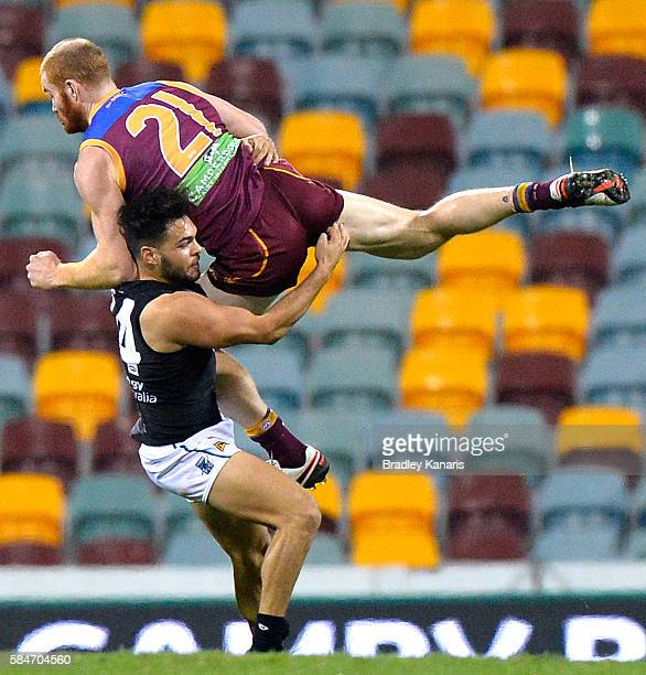 Daniel Merrett of the Lions and Jarman Impey of the Port Adelaide Power collide during the round 19 AFL match between the Brisbane Lions and the Port...