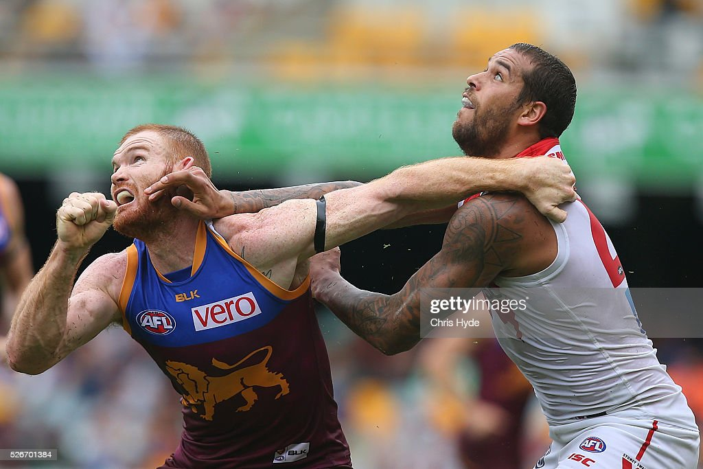 Daniel Merrett of the Lions and Lance Franklin of the Swans compete for the ball during the round six AFL match between the Brisbane Lions and the Sydney Swans at The Gabba on May 1, 2016 in Brisbane, Australia.