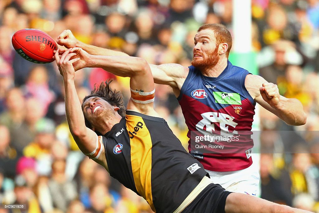 Daniel Merrett of the Lions spoils a mark by Tyrone Vickery of the Tigers during the round 14 AFL match between the Richmond Tigers and the Brisbane Lions at Melbourne Cricket Ground on June 25, 2016 in Melbourne, Australia.
