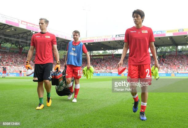 Daniel Mesenhoeler Peter Kurzweg and Atsuto Uchida of 1FC Union Berlin before the game between Union Berlin and Arminia Bilefeld on august 27 2017 in...