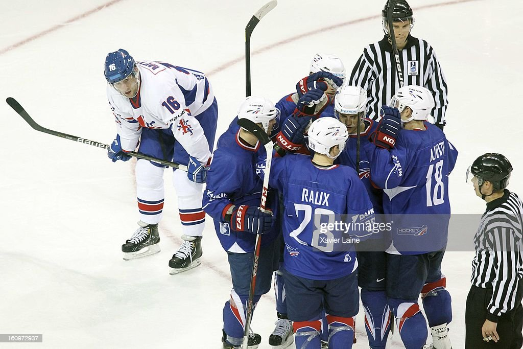 Daniel Meyers of Great Britain reacts as France players celebrate during the Sochi 2014 Olympic Ice Hockey Qualification match between France and Great Britain at Riga Arena on February 8, 2013 in Riga, Latvia.