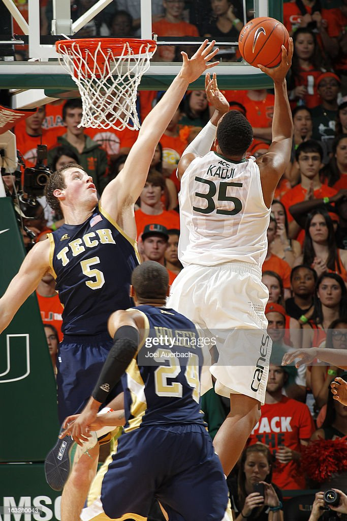 Daniel Miller #5 of the Georgia Tech Yellow Jackets defends against Kenny Kadji #35 of the Miami Hurricanes on March 6, 2013 at the BankUnited Center in Coral Gables, Florida. Georgi Tech defeated Miami 71-69.