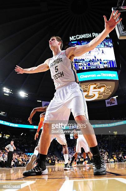 Daniel Miller of the Georgia Tech Yellow Jackets defends an inbounds pass against the Miami Hurricanes at McCamish Pavilion on January 18 2014 in...