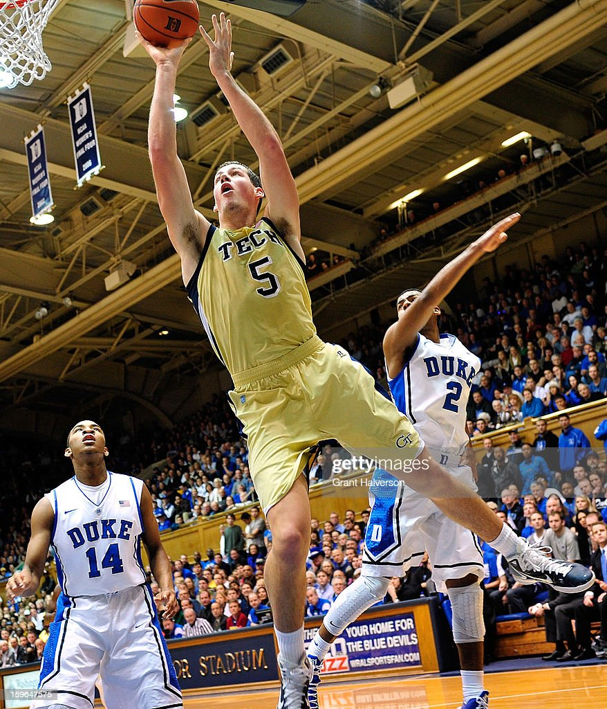 Daniel Miller #5 of the Georgia Tech Yellow Jackets drives to the basket against defenders <a gi-track='captionPersonalityLinkClicked' href=/galleries/search?phrase=Rasheed+Sulaimon&family=editorial&specificpeople=7887134 ng-click='$event.stopPropagation()'>Rasheed Sulaimon</a> #14 and <a gi-track='captionPersonalityLinkClicked' href=/galleries/search?phrase=Quinn+Cook&family=editorial&specificpeople=6753591 ng-click='$event.stopPropagation()'>Quinn Cook</a> #2 of the Duke Blue Devils during play at Cameron Indoor Stadium on January 17, 2013 in Durham, North Carolina.