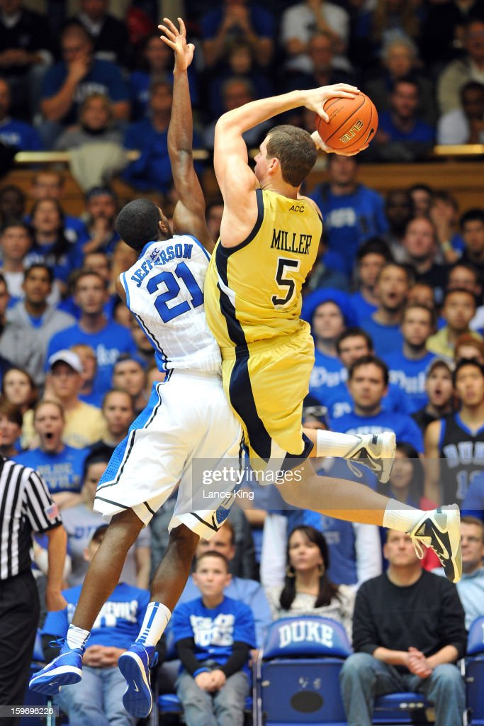 Daniel Miller #5 of the Georgia Tech Yellow Jackets puts up a shot against Amile Jefferson #21 of the Duke Blue Devils at Cameron Indoor Stadium on January 17, 2013 in Durham, North Carolina. Duke defeated Georgia Tech 73-57.
