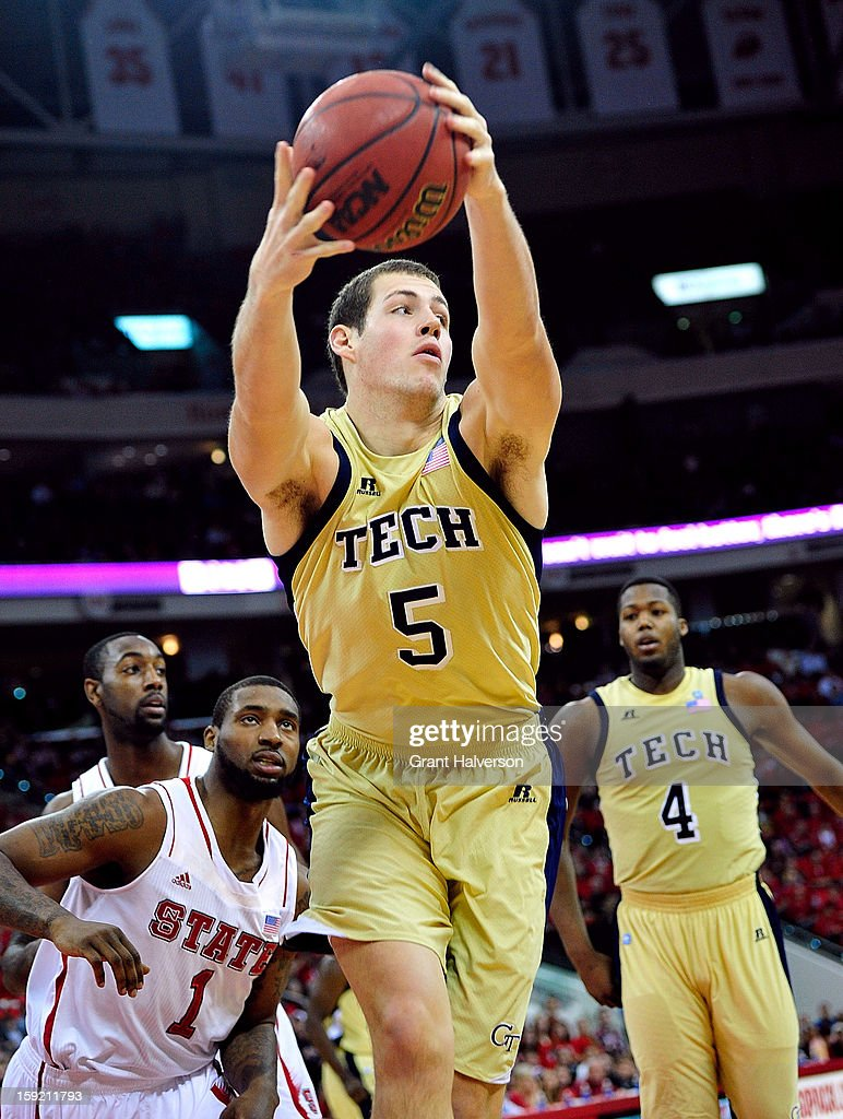 Daniel Miller #5 of the Georgia Tech Yellow Jackets rebounds against the North Carolina State Wolfpack during play at PNC Arena on January 9, 2013 in Raleigh, North Carolina.