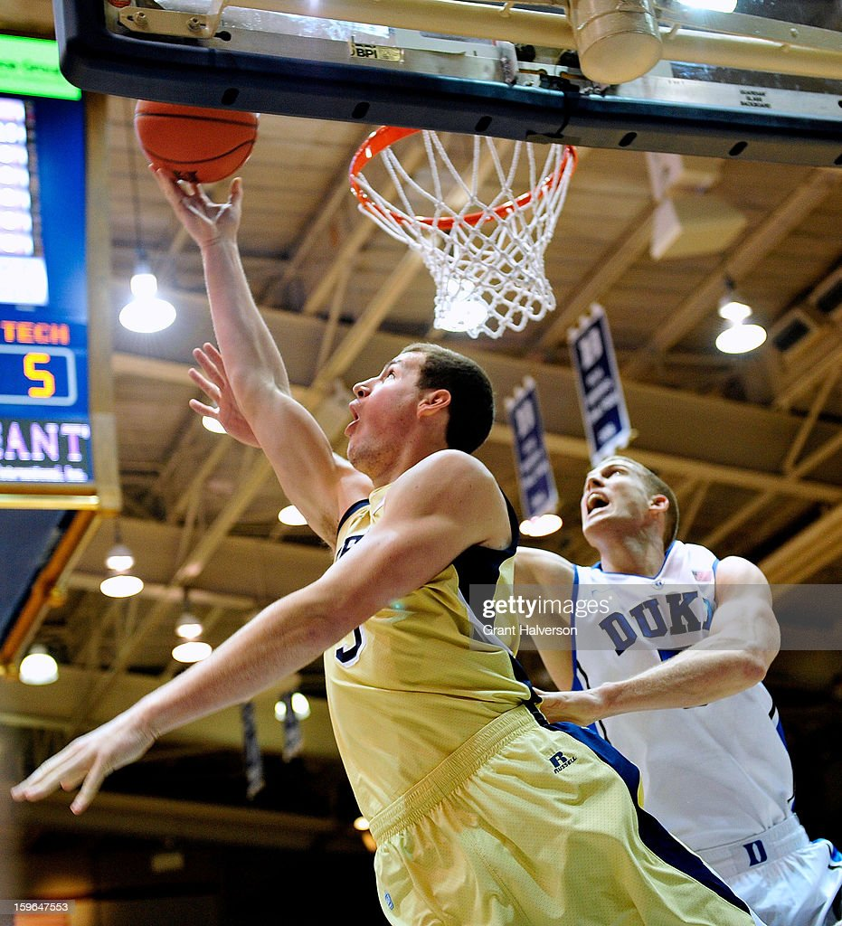 Daniel Miller #5 of the Georgia Tech Yellow Jackets scores over <a gi-track='captionPersonalityLinkClicked' href=/galleries/search?phrase=Mason+Plumlee&family=editorial&specificpeople=5792012 ng-click='$event.stopPropagation()'>Mason Plumlee</a> #5 of the Duke Blue Devils during play at Cameron Indoor Stadium on January 17, 2013 in Durham, North Carolina.