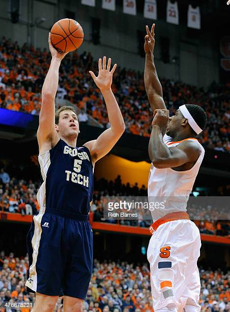 Daniel Miller of the Georgia Tech Yellow Jackets takes a shot against the defense of CJ Fair of the Syracuse Orange during the first half at the...