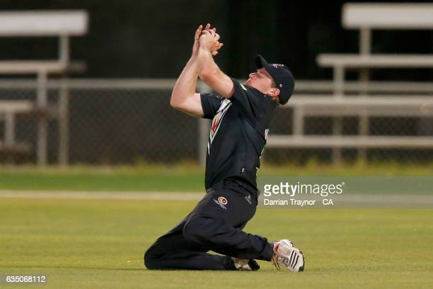 Daniel Mock of Victoria takes a catch to dismiss the fianl batsman during the National Indigenous Cricket Championships match between New South Wales...