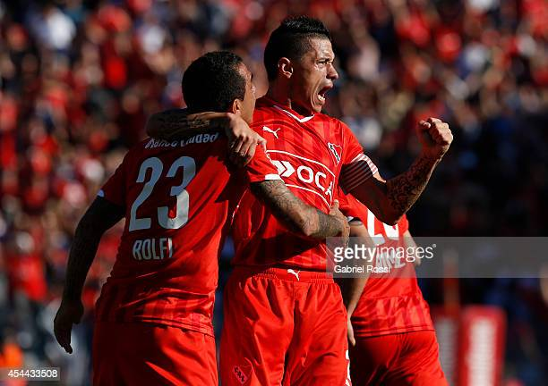 Daniel Montenegro and Cristian Tula of Independiente celebrates after Federico Mancuello scored the second goal against Racing during a match between...