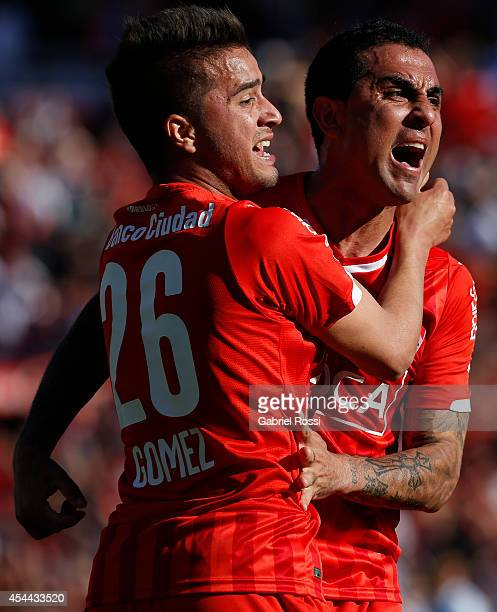 Daniel Montenegro and Rodrigo Gomez of Independiente celebrates after Federico Mancuello scored the second goal against Racing during a match between...
