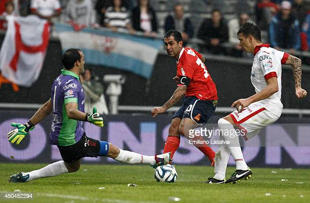 Daniel Montenegro of Independiente kicks the ball as goalkeeper of Huracn Marcos Daz and Victor Cuesta try to block the shot during a tiebreaker...