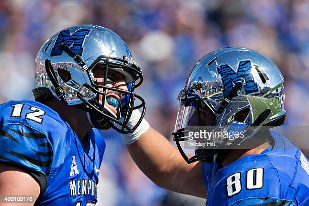 Daniel Montiel celebrates with Paxton Lynch of the Memphis Tigers after a touchdown against the Ole Miss Rebels at Liberty Bowl Memorial Stadium on...