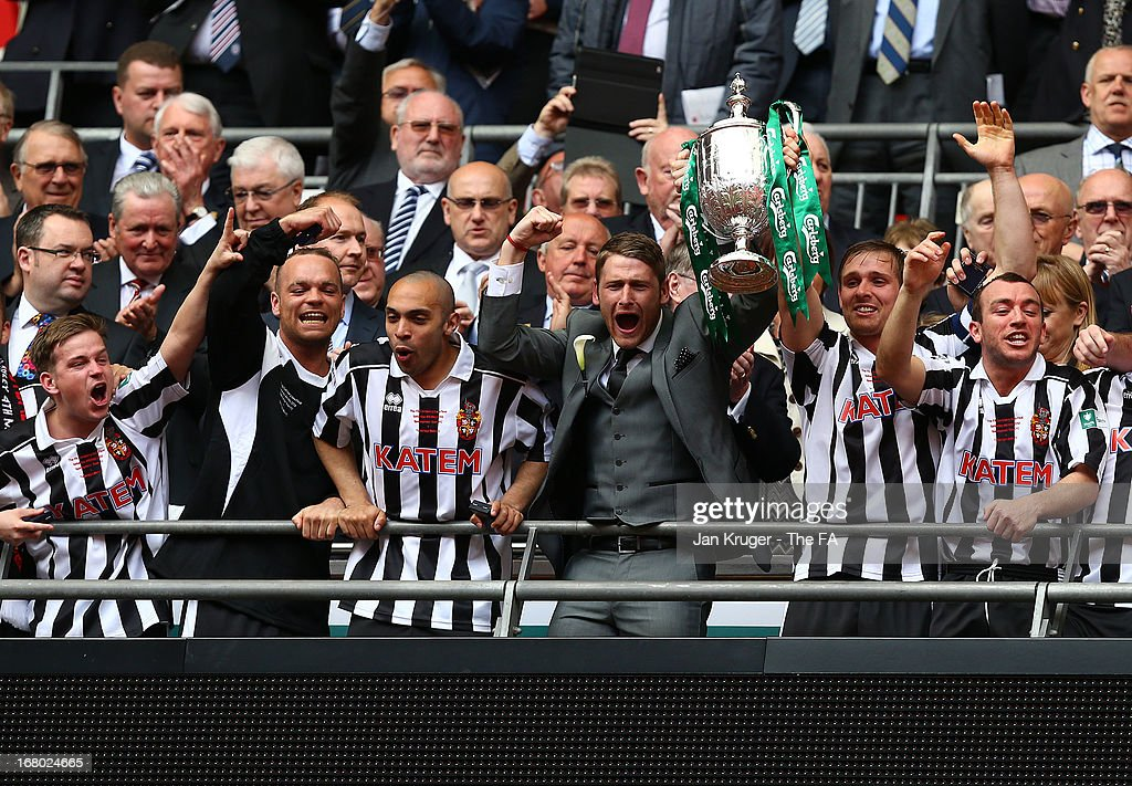Daniel Moore and Chris Mason of Spennymoor Town lifts the trophy during the FA Carlsberg Vase Final match between Spennymoor Town FC and Tunbridge Wells FC at Wembley Stadium on May 4, 2013 in London, England.