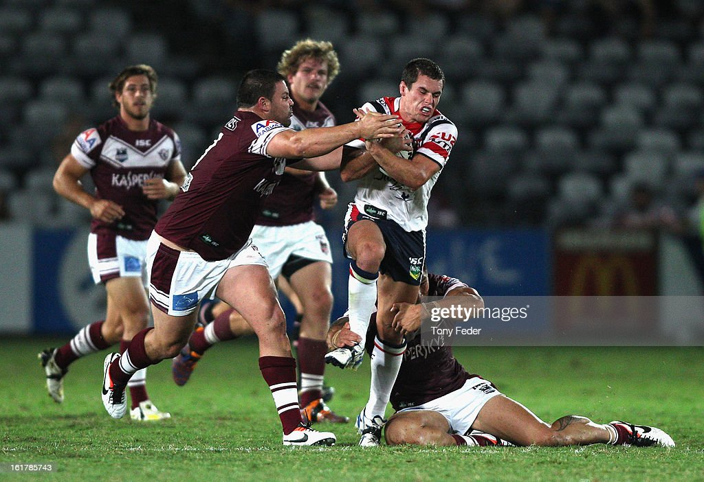 Daniel Mortimer of the Roosters tries to break the Sea Eagles defence during the NRL trial match between the Manly Sea Eagles and the Sydney Roosters at Bluetongue Stadium on February 16, 2013 in Gosford, Australia.
