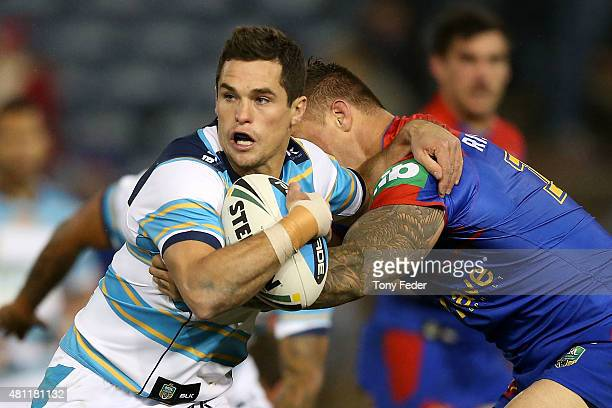 Daniel Mortimer of the Titans is tackled during the round 19 NRL match between the Newcastle Knights and the Gold Coast Titans at Hunter Stadium on...
