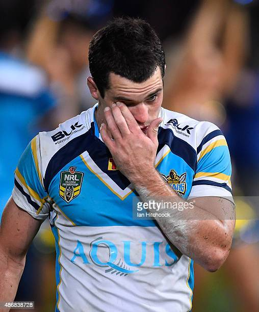 Daniel Mortimer of the Titans looks dejected after losing the round 26 NRL match between the North Queensland Cowboys and the Gold Coast Titans at...