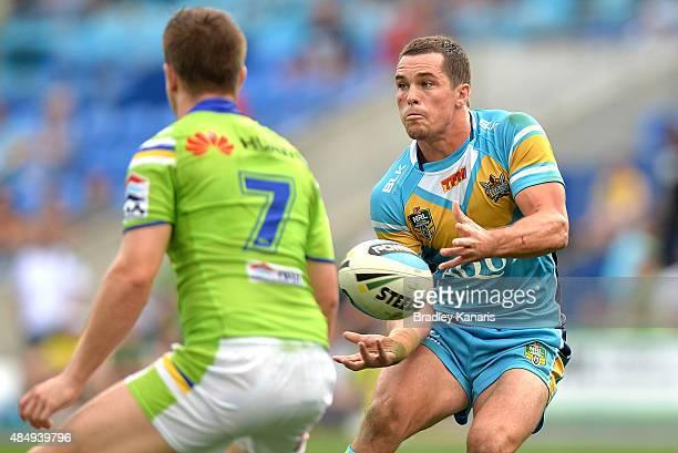 Daniel Mortimer of the Titans passes the ball during the round 24 NRL match between the Gold Coast Titans and the Canberra Raiders at Cbus Super...