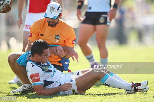 Daniel Mortimer of the Titans receives attention from the trainer during the round six NRL match between the Cronulla Sharks and the Gold Coast...