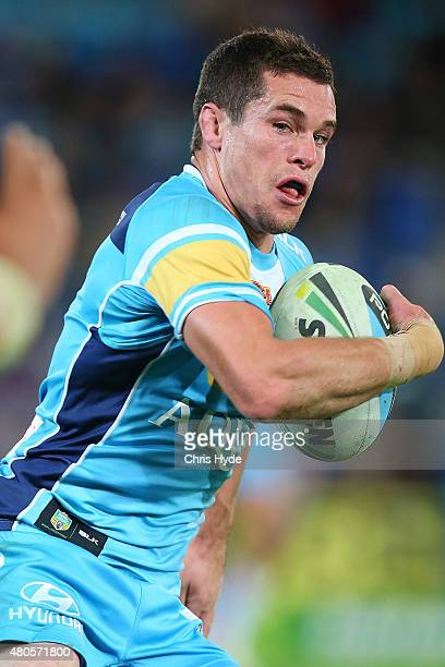 Daniel Mortimer of the Titans runs the ball during the round 18 NRL match between the Gold Coast Titans and the Manly Sea Eagles at Cbus Super...