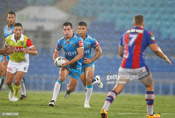 Daniel Mortimer of the Titans runs with the ball during the round one NRL match between the Gold Coast Titans and the Newcastle Knights at Cbus Super...